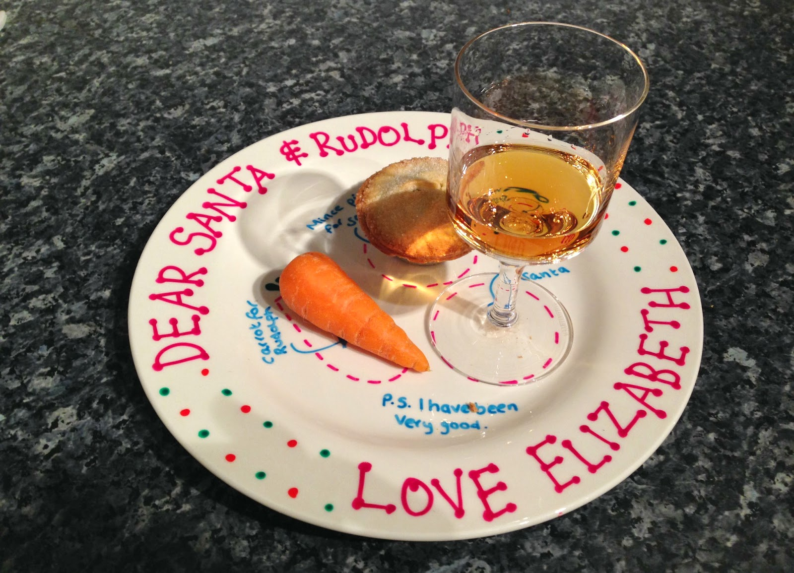Carrot mince pie and drink for Santa on plate