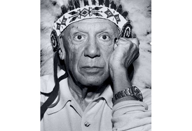 photo of Pablo Picasso Wearing a Rolex GMT-Master and Native American War Bonnet it the 1960s