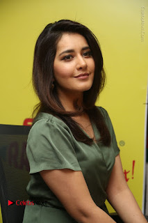 Actress Raashi Khanna Stills in Green Short Dress at Mirchi 95 Suno Aur Mercedes Jeeto Contest  0121.JPG