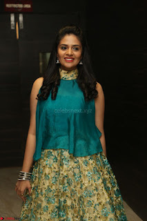 Anchor Srimukhi in green sleeveless top and skirt at O Pilla Nee Valla Movie Audio Launch Feb 2017 108.JPG