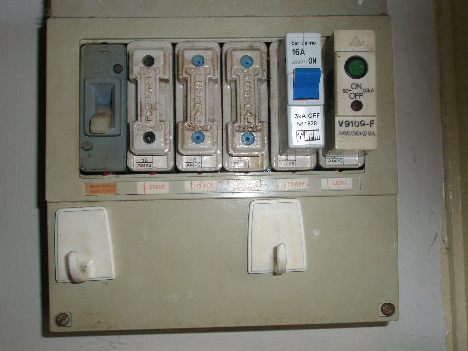 a later switchboard combining original fuses with plug in circuit breakers please note that circuit breakers are not safety switches  [ 1600 x 1200 Pixel ]