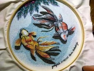 yellow-red-and-white-orange-goldfish embroidered by Java Harmony