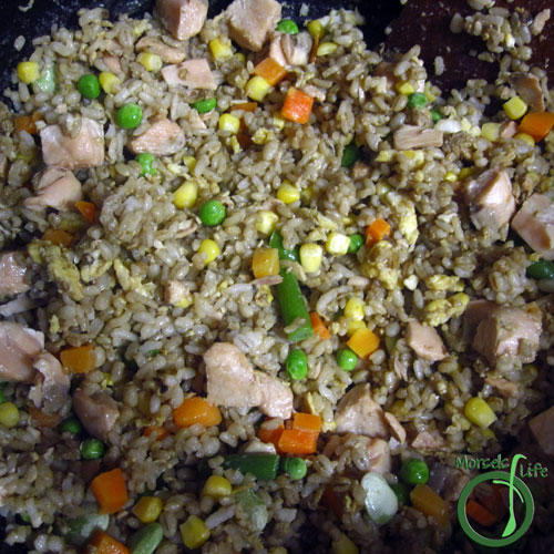 Morsels of Life - Salmon Fried Rice Step 5 - When salmon is mostly done, add in veggies, and cook until everything heated.