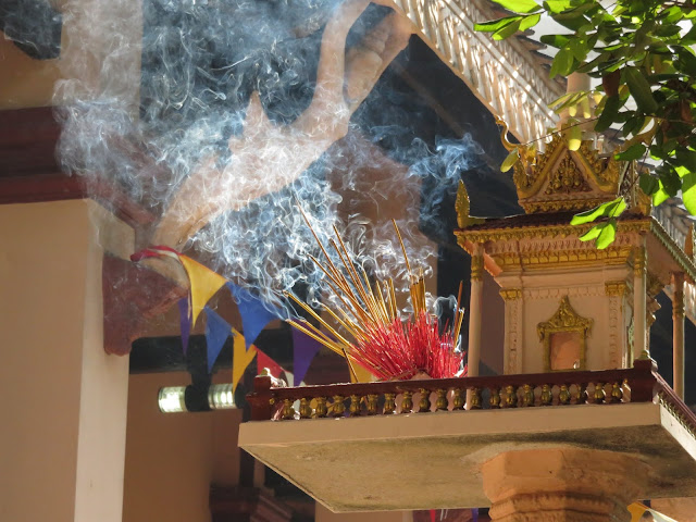 Incense burning at Wat Phnom in Phnom Penh Cambodia