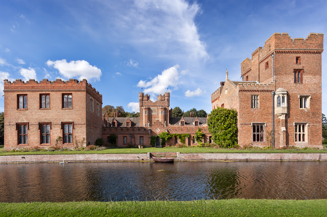 Oxburgh Hall and rowing boat on the moat