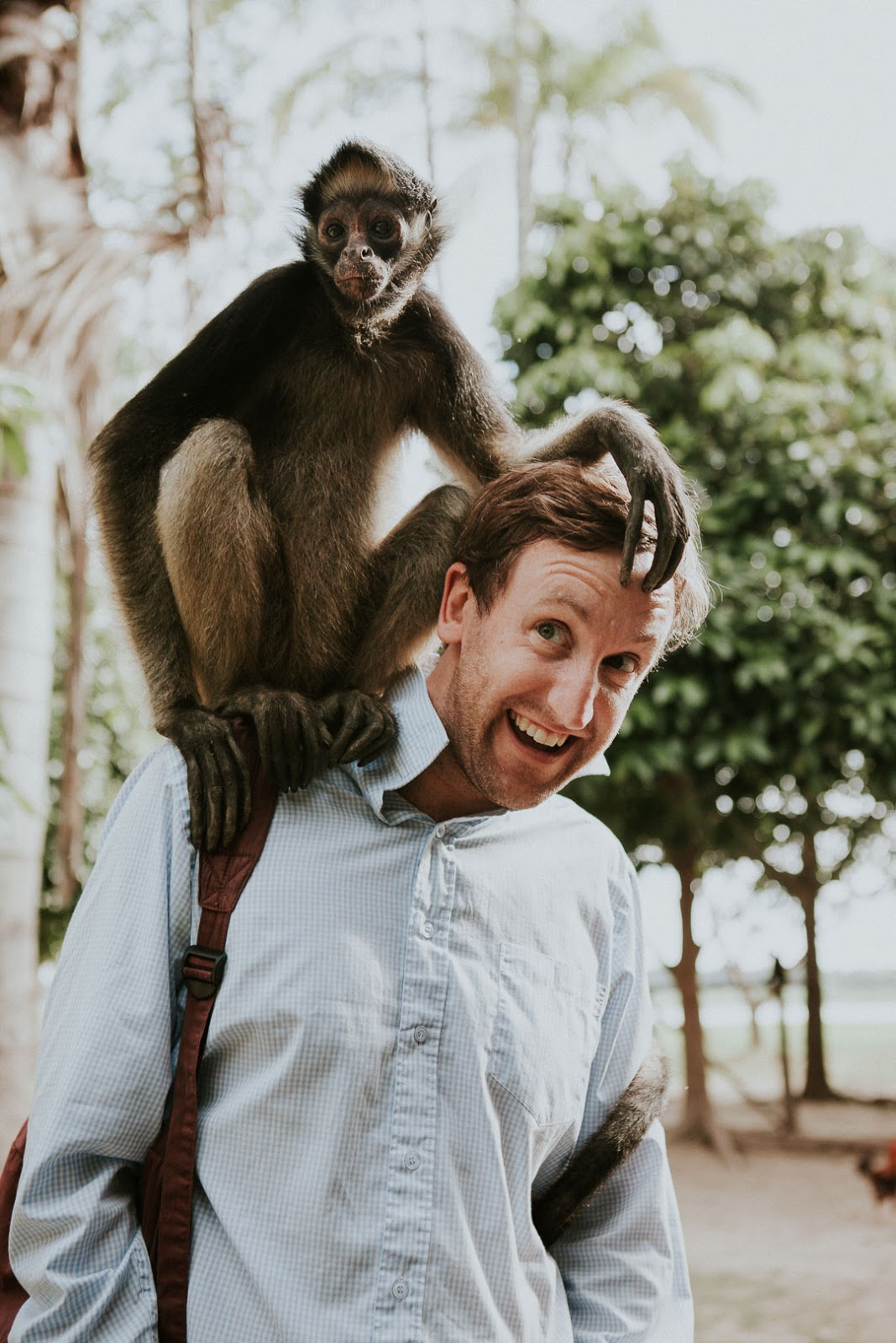 Chris Reed and monkey in the Amazonian jungle