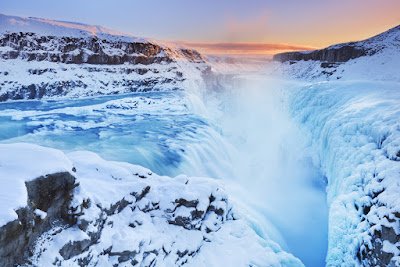 Frozen Gullfoss waterfall at sunset is part of any 5-day itinerary in Iceland