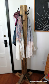 use a reclaimed wood fence post to make a coat tree