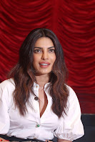 Priyanka Chopra in White Shirt and Colorful Skirt at Baywatch Press Conference  15th May 2017 ~  Exclusive 07.jpg
