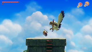 screenshot of Link fighting the Evil Eagle in the Link's Awakening remake on top of the Eagle's Tower