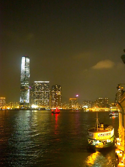 View of ICC and Star Ferry at night from Hong Kong