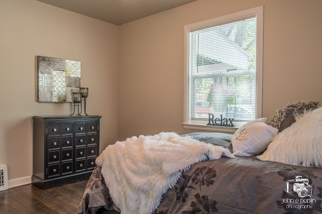 a staged bedroom at a Denver home for sale in Colorado