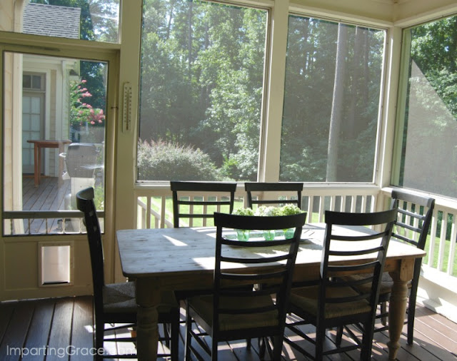 Dining area of screened porch leads out to deck