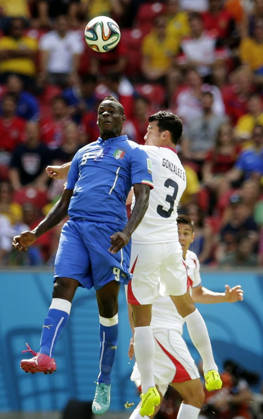 Italy's Mario Balotelli, left, and Costa Rica's Giancarlo Gonzalez head the ball during the group D World Cup soccer match between Italy and Costa Rica at the Arena Pernambuco in Recife, Brazil, Friday, June 20, 2014.