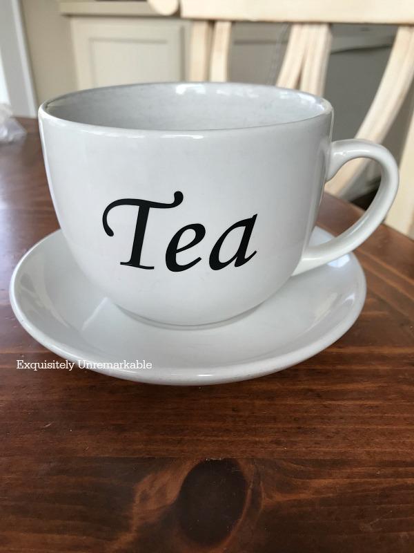 Tea Cup With A Black Vinyl Transfer
