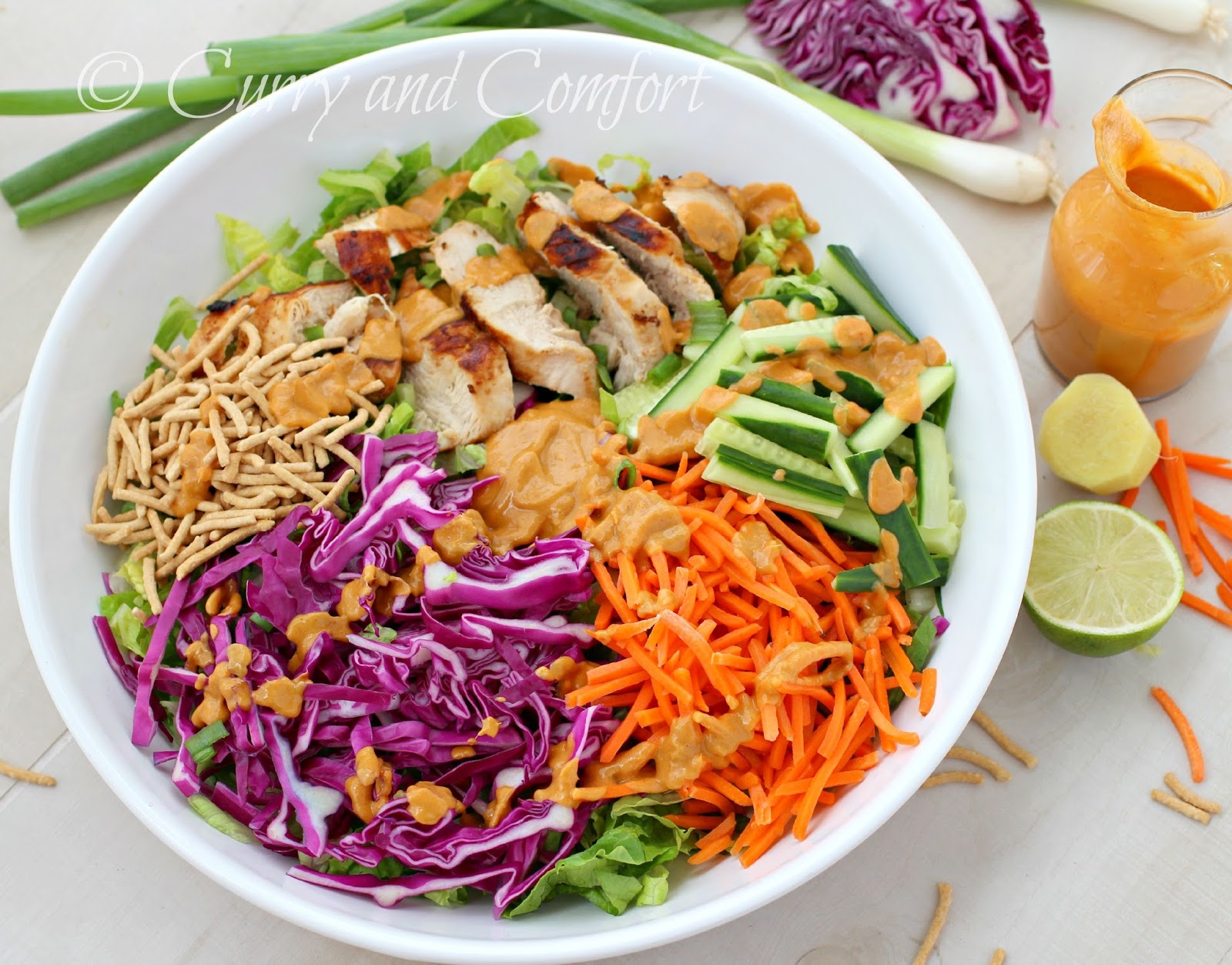grilled chicken salad with spicy peanut dressing is a hearty salad ...