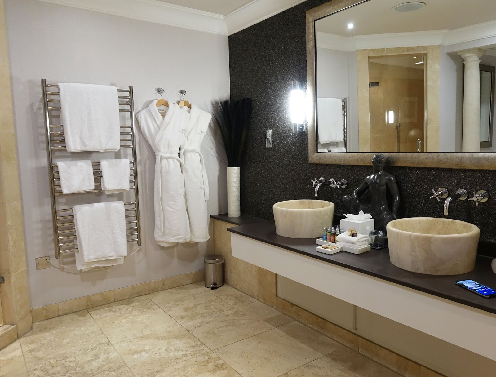 The bathroom with large bath and L 'Occitane toiletries at Alexander House Hortel and Spa