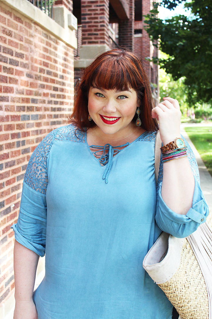 Plus Size Blogger Amber from Style Plus Curves models a Blue Top with Lace insets and a Lace Up neckline from Skye's the Limit Boutique