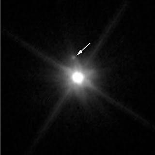 Moon Orbiting the Dwarf Planet Makemake