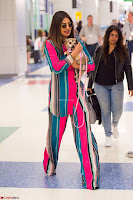 Priyanka Chopra in Colorful Jumpsuit arriving at JFK Airport New York 18 June 2017 ~  Exclusive 033.jpg