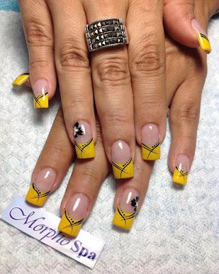 diseño de uñas estilo francés amarillas de moda