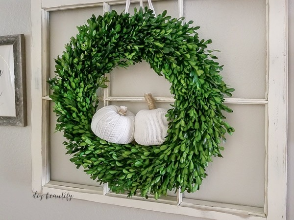 antique window with wreath and pumpkins