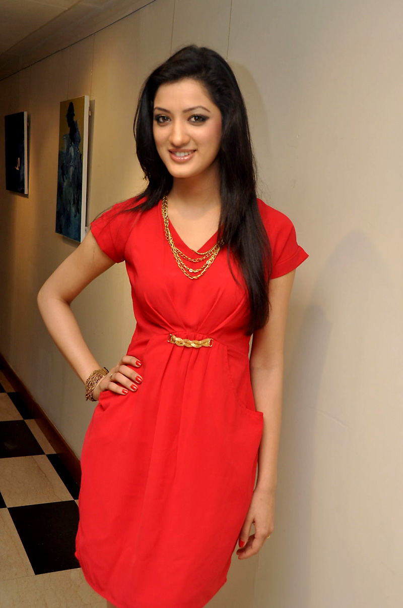 Cute richa panai in red gown
