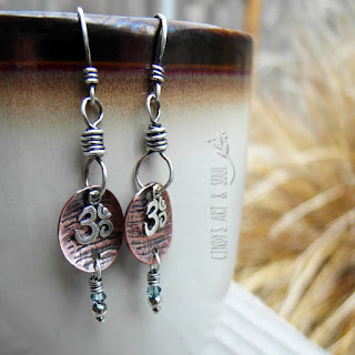 http://www.artandsouljewelry.com/collections/new-jewelry/products/silver-earrings-om-dangle-mixed-metals