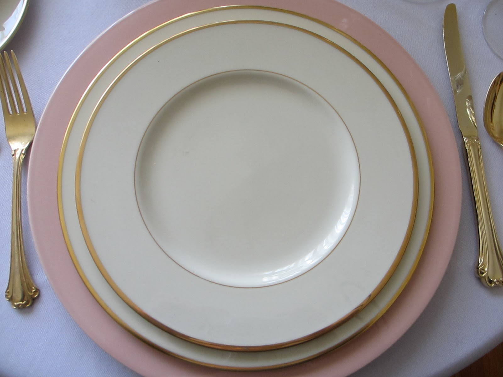 Pat used a Mikasa Rose  Color Spectrum  charger then a Lenox  Mansfield  dinner and luncheon plate beneath the Fitz u0026 Floyd  Hummingbird  accent plate & Table for One: Hummingbird Table