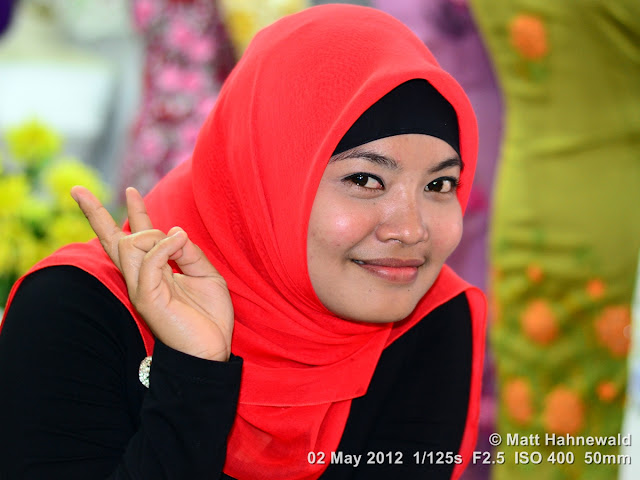 people, Indonesian Muslim lady, street portrait, headshot, Indonesia; Sumatra, Bukittinggi, beauty, red hijab, V sign