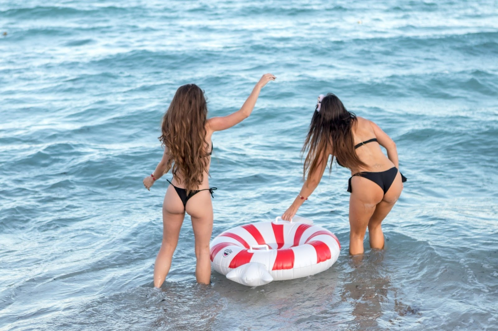 Claudia Romain and Melissa Lori exposing their sexy ass booty in Black Bikini July 2018