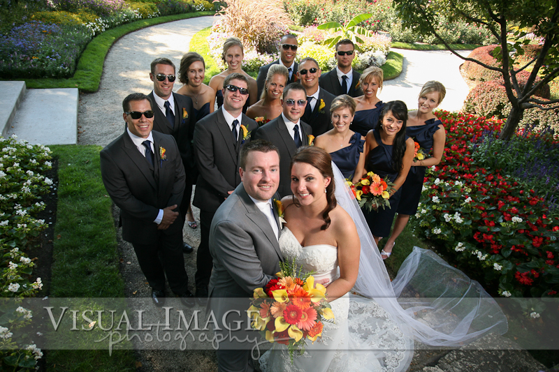 Group photo of wedding party in formal gardens in Frame Park