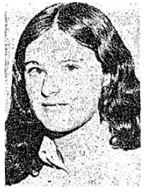 Close up of a young woman's face, smiling enigmatically