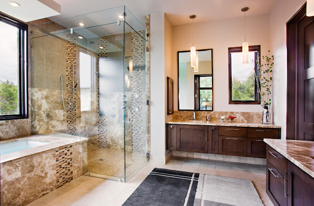 Photo of big modern bathroom with glassy shower cabin