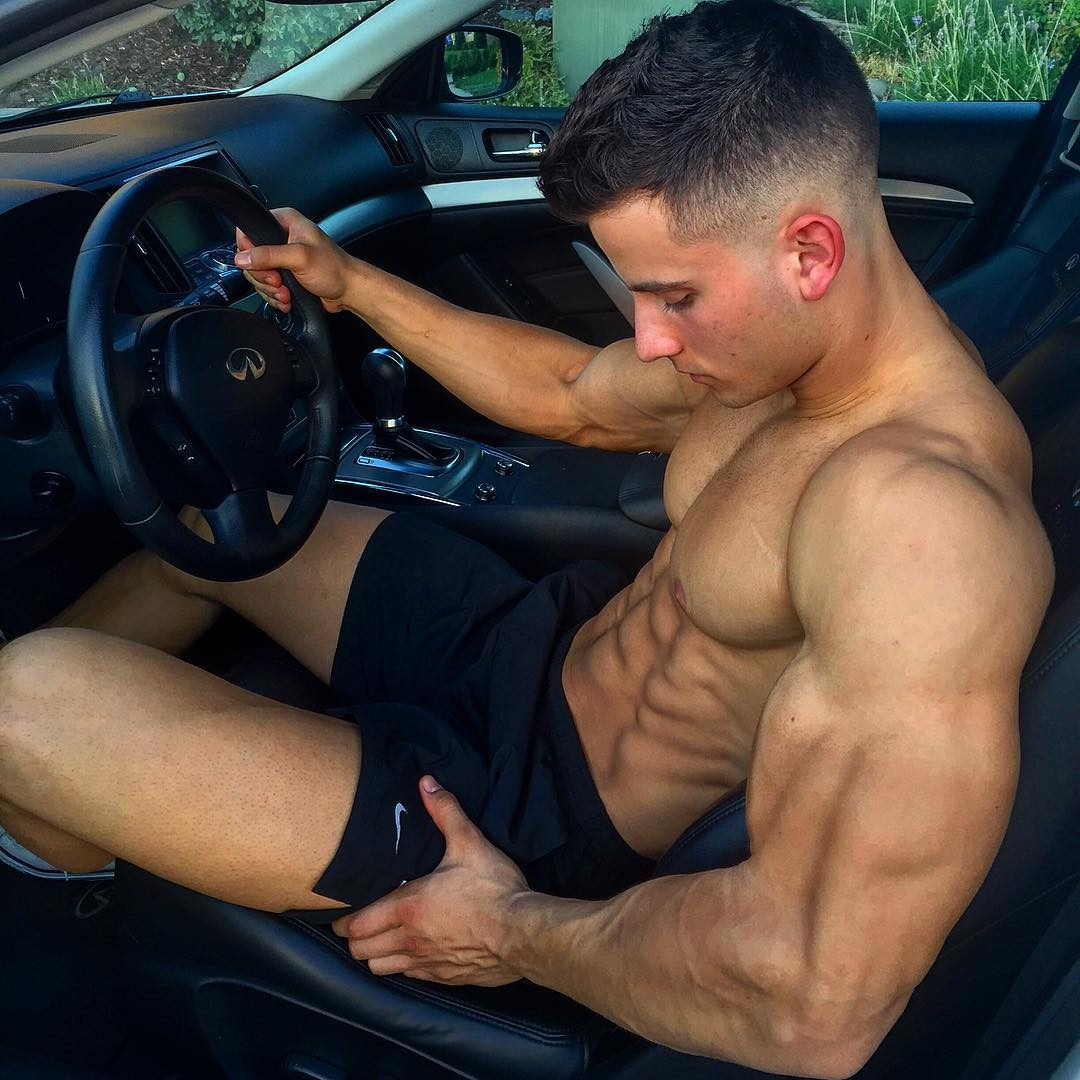 handsome-dark-haired-car-driver-abs-biceps