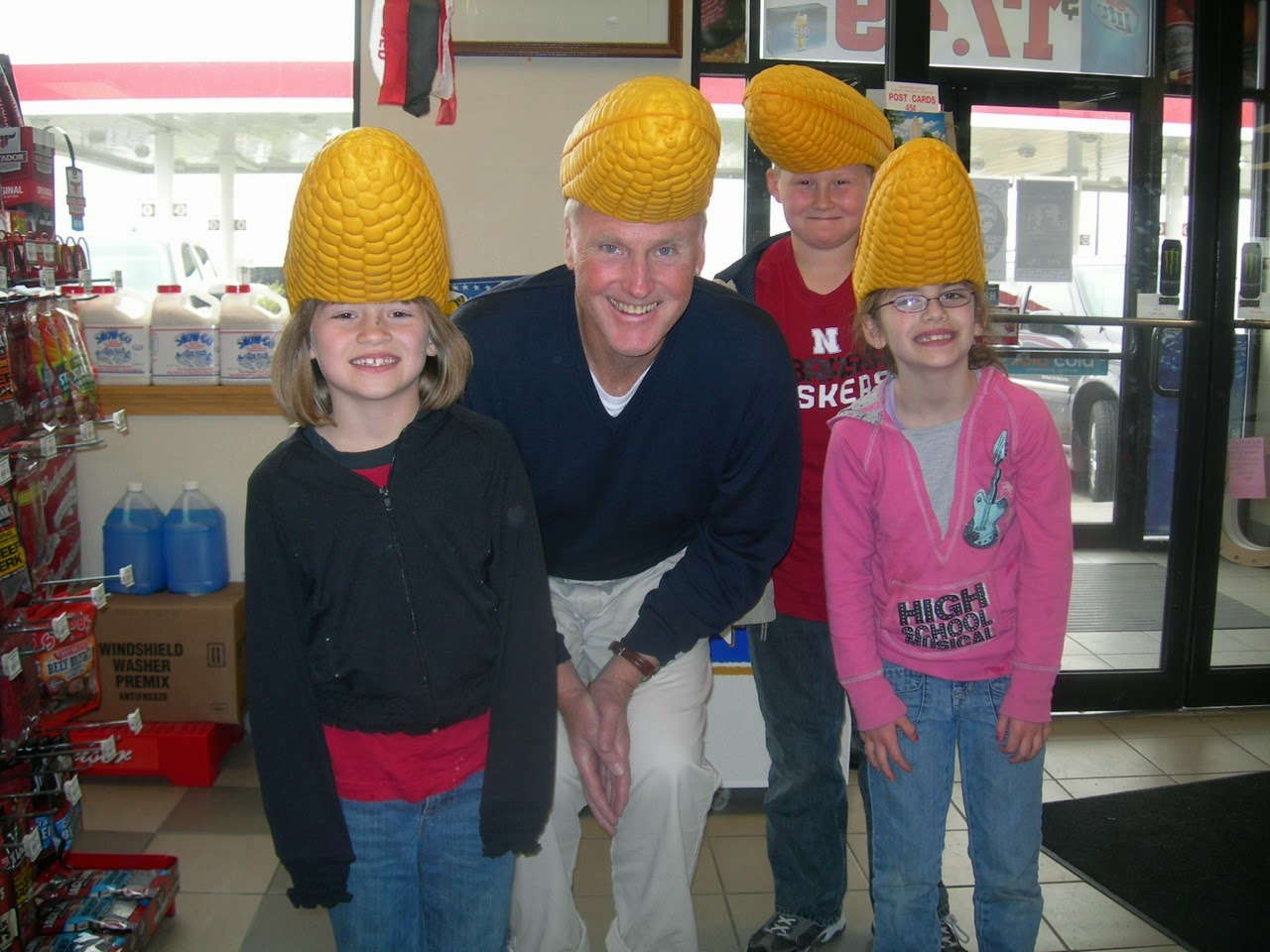 3720456d1a0 Corn Cob Head Hats on sale at BP station near Cornhusker Stadium. La  Nancita snapped a trying-it-on foto of Old Poppy and some of his young pals.