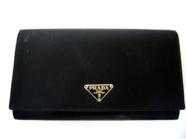 9badf8c1c1945d Recently I noticed a few of my Prada bags are dirty. Well, taking gal pal's  advise, I wiped a Prada nylon wallet (with grainy leather interior) with a  mild ...