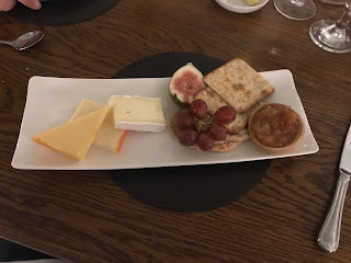 cheese and crackers on plate with figs