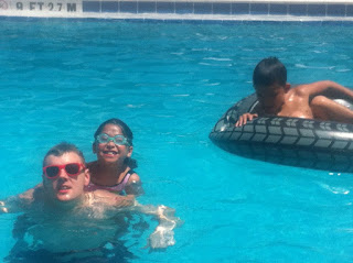 Playing in the pool with my twin cousins.