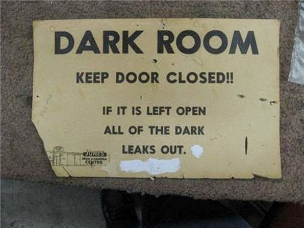 Funny African dark room sign picture - keep door closed - if it is left open all of the dark leaks out