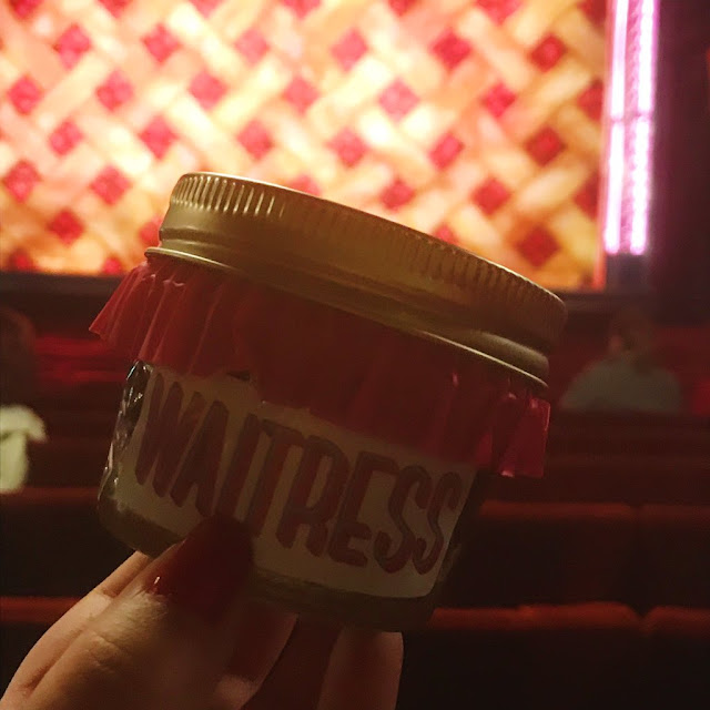 Photo of pie at Waitress, stage in the background
