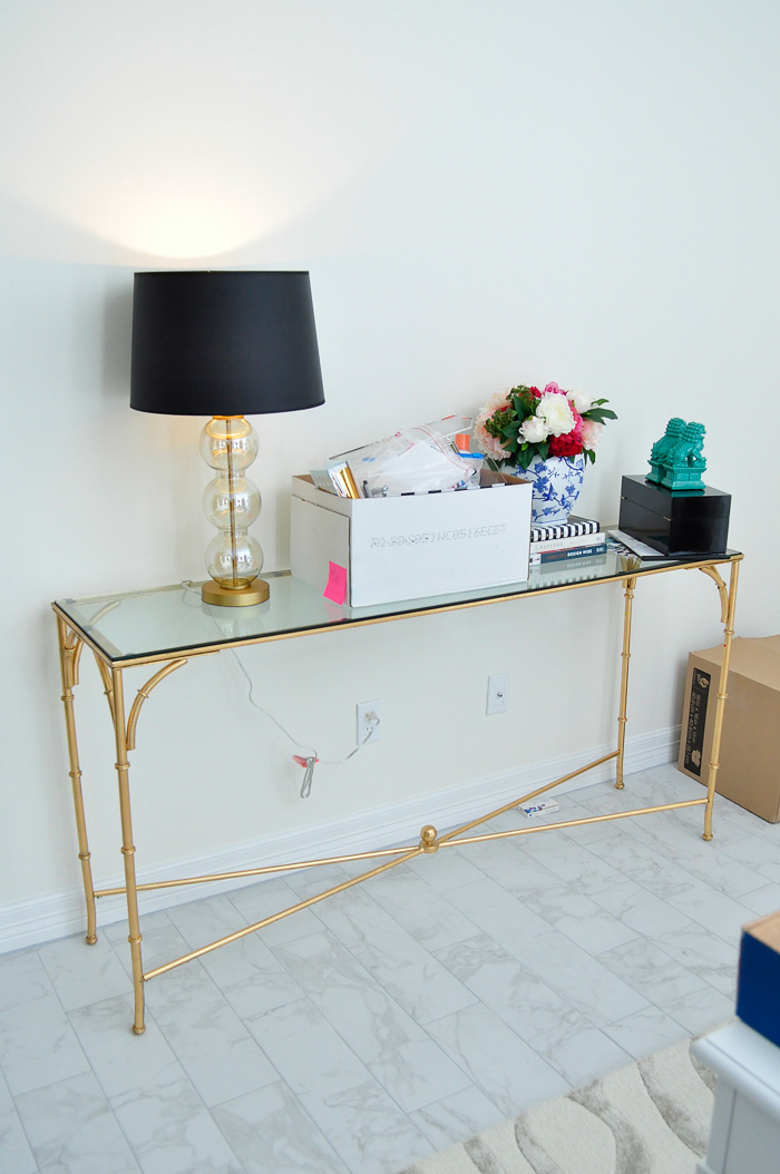 Gilt bamboo console table in an office.