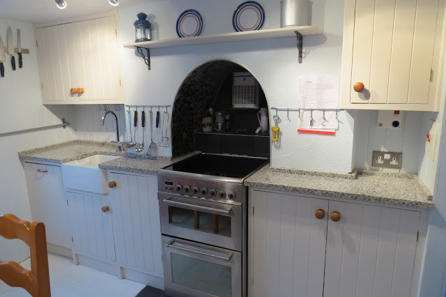bianco diamante granite with white cabinets