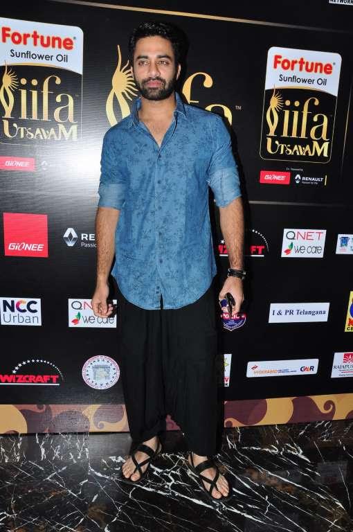 Telugu actor Navdeep poses for photographers upon arrival at IIFA Utsavam  press meet