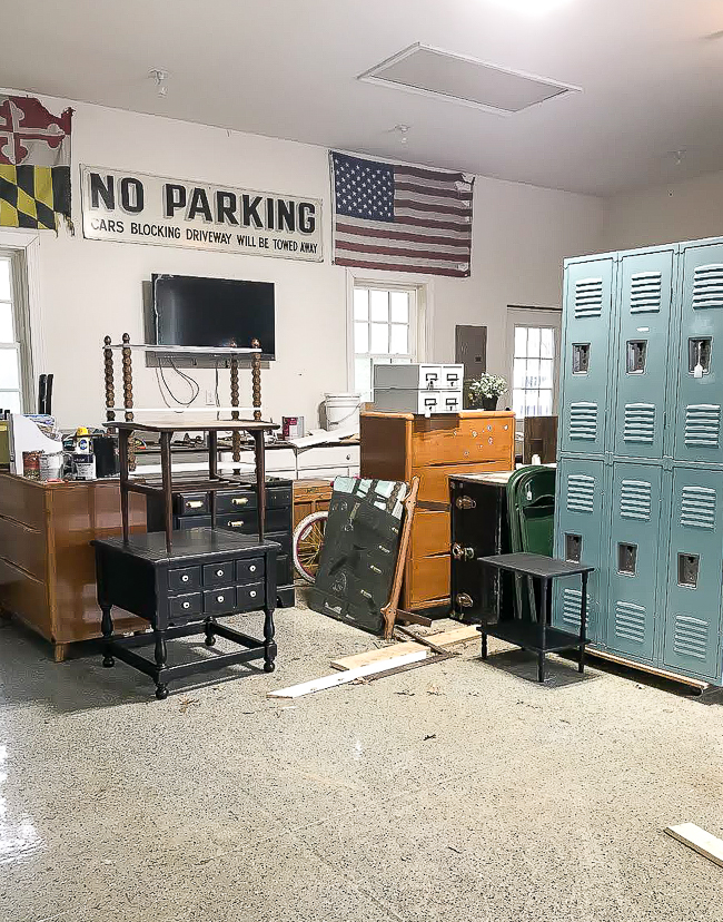 Garage full of thrifted vintage lockers and furniture