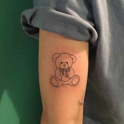 Arms teddy bear tattoo