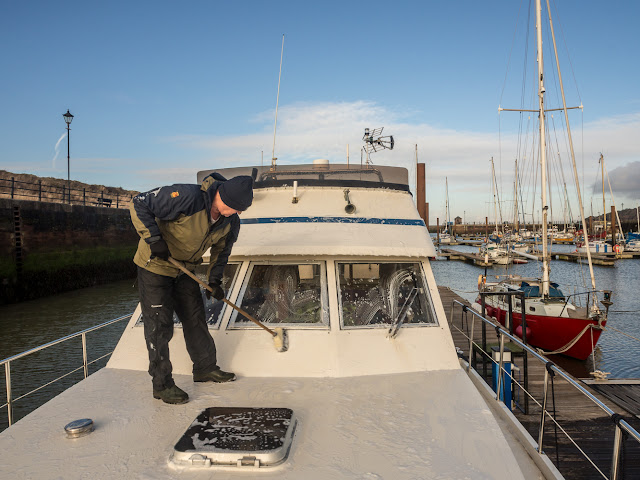Photo of Phil washing Ravensdale with boat wash