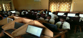 Section of Students writing Exams with Computer