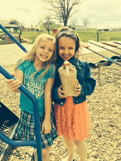 Two young girls holding their egg project