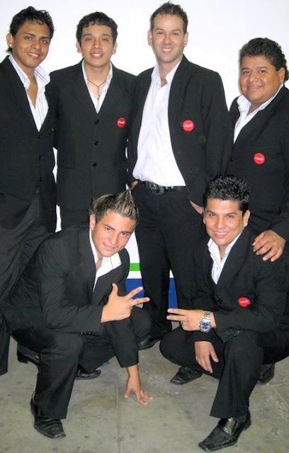 Foto de integrantes del Grupo América sonriendo